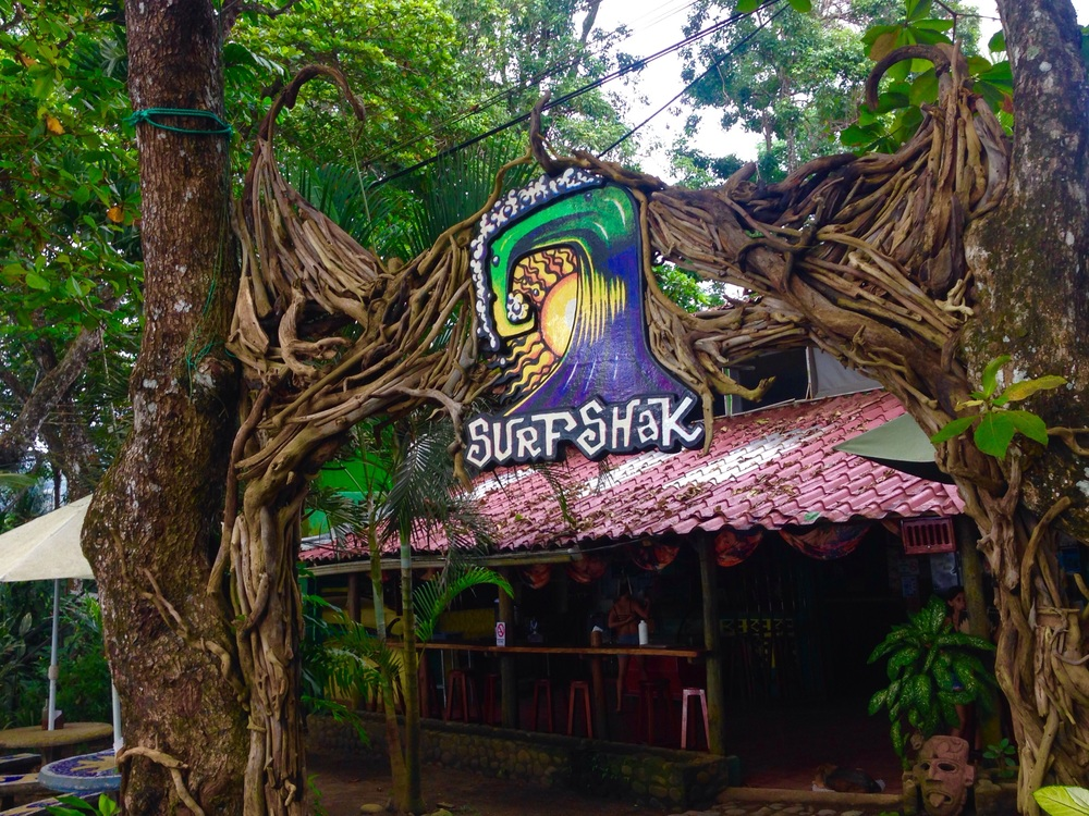 The Surf Shak is one of many bar/restaurants, along with hostels down Playa Dominical's long road.