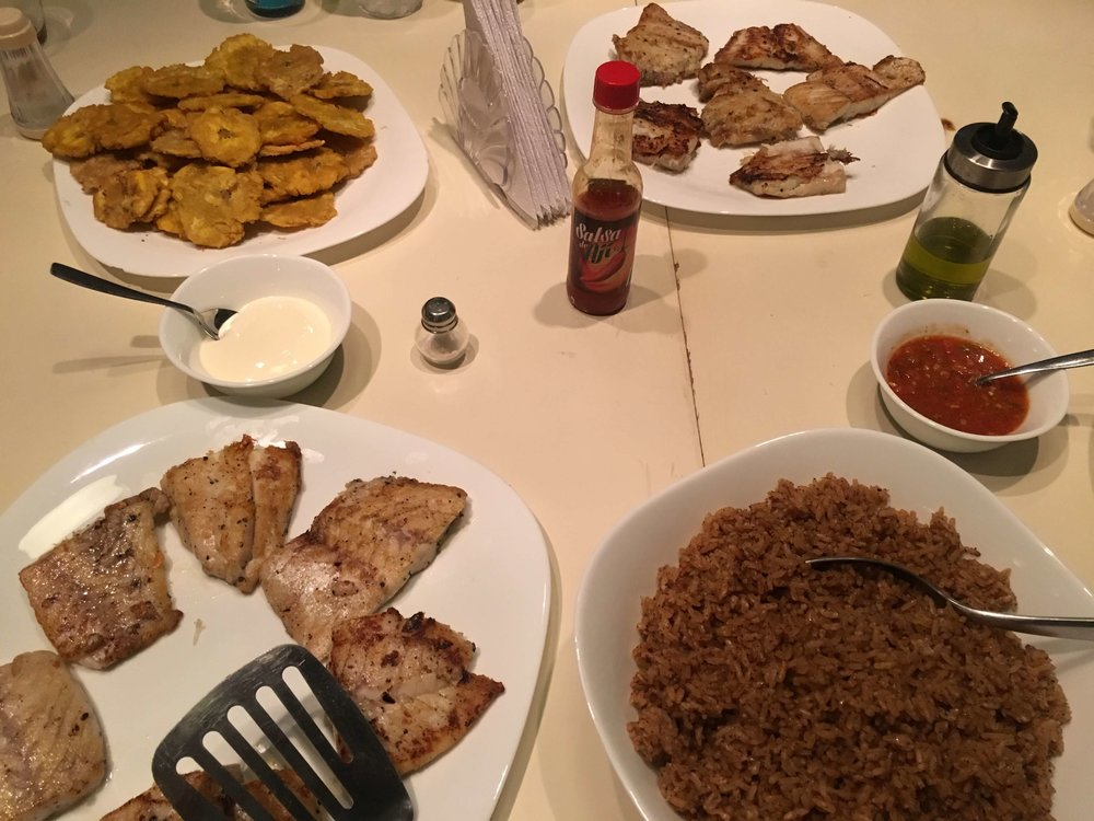 Traditional caribbean dinner!  (Fried fish, coconut rice, and patacones)