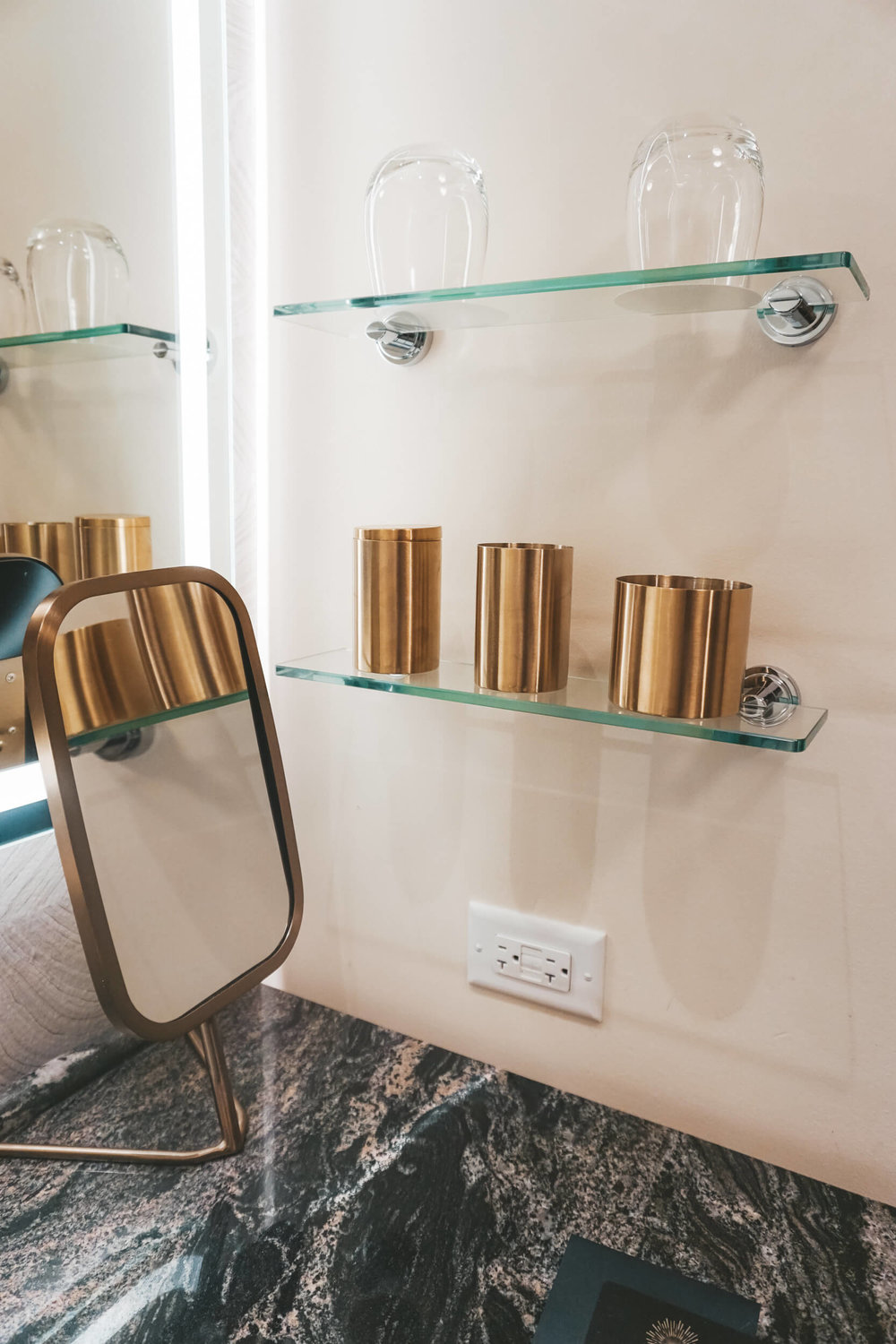 Gold art deco bathroom accessories at Viceroy Chicago