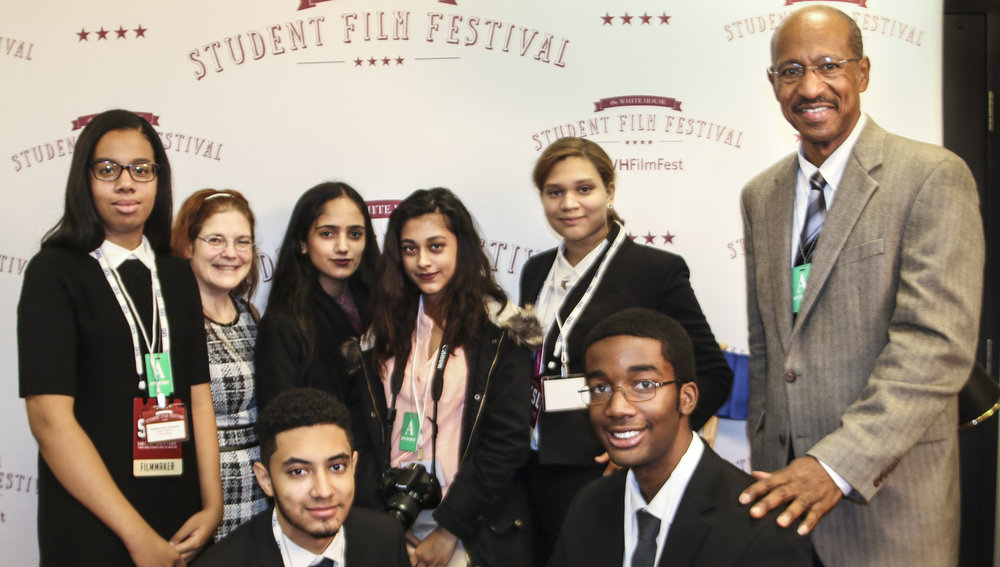 Digital Media Training program students, 2016 Winners of the 3rd Annual White House Student Film Festival. Natalie Cabrera, Joann Mariani (Journalism Instructor), Faeyah Muhammad, Samia Uddin, Nicoles Rasoario, Melvin McCray (Program Director), (kneeling) Justin Rivera, and Matthew Smart.