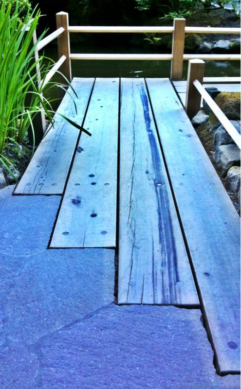 I really enjoyed how the light and staggered lengths make the wooden path seem to be an organic extension of the stone.