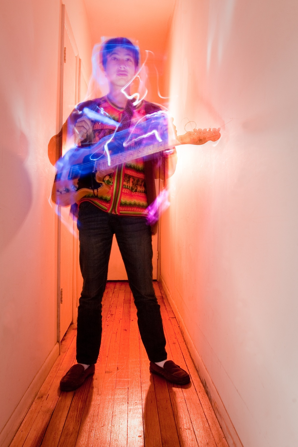 Dustin Wong - Photo by Valerie Paulsgrove (Site at vjpphotography.com) - Neon Guitar Hallway.jpg