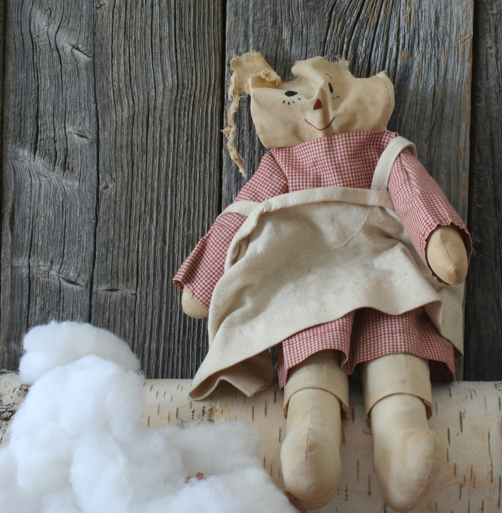 Laura's doll in desperate need of repair.