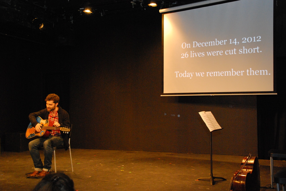 """Adam Cohen performing """"Imagine"""" at the tribute to the 26 victims of the Sandy Elementary School massacre on the first anniversary--December 14, 2013"""
