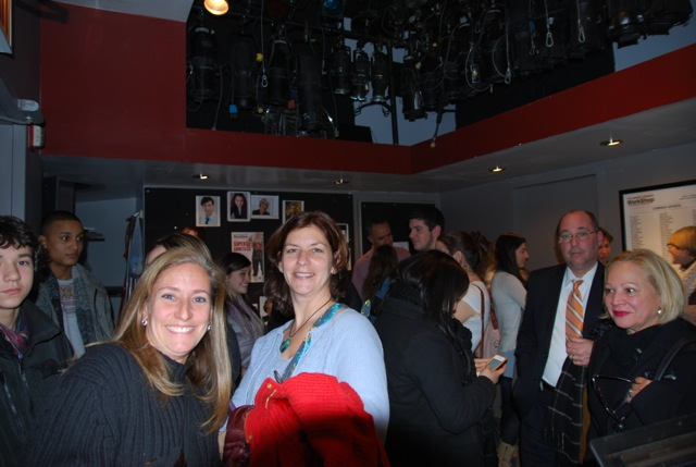Audience members mingle in the lobby before a show