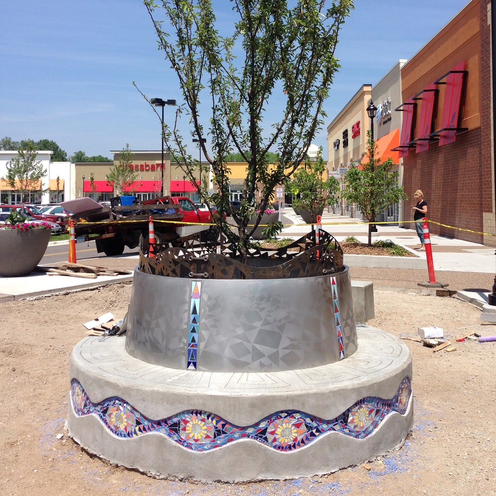 Recently completed Public Art Sculpture: Knollwood mall planter bench in collaboration with artist Greta Mclain, concrete, stainless steel, corten steel and mosaic tile. 8' diameter
