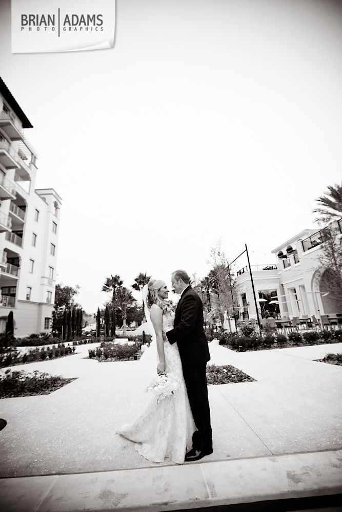 Bride and groom first look at the Alfond Inn, beaded wedding dress, white bridal flowers, photo by Orlando Florida wedding photographer Brian Adams PhotoGraphics,  brianadamsphoto.com