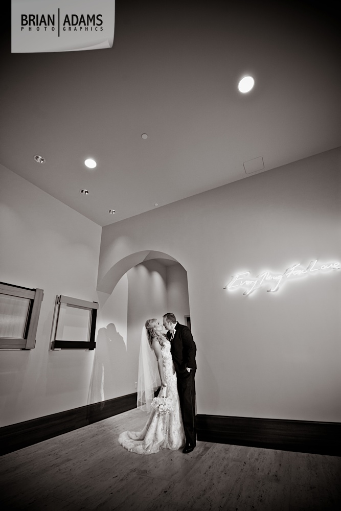 Bride and groom first look at the Alfond Inn, beaded wedding dress, white bridal flowers, black and white wedding photo by Orlando Florida wedding photographer Brian Adams PhotoGraphics,  brianadamsphoto.com