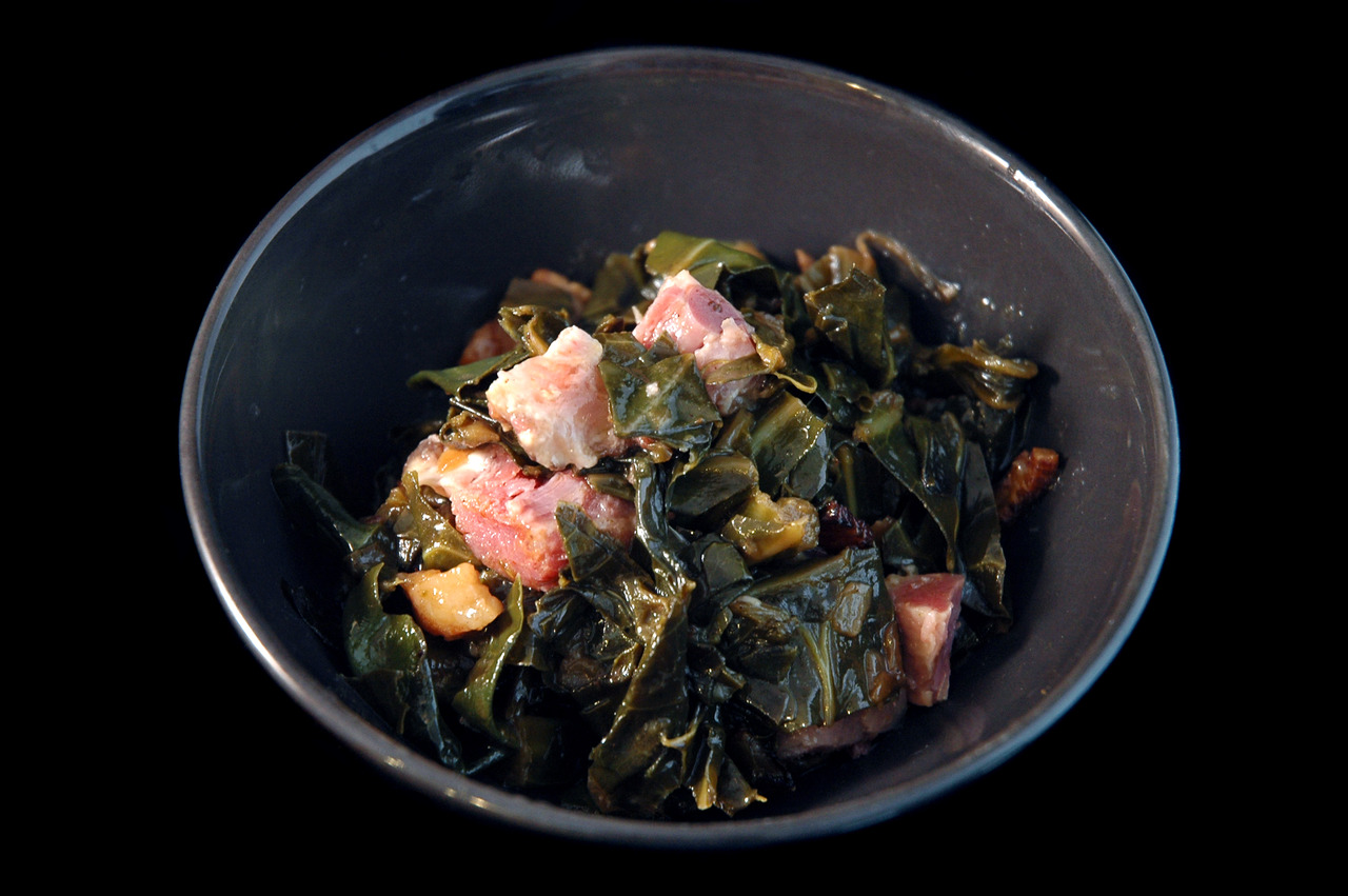 COLLARD GREENS   braised ham-hocks - bacon   1. cut collard greens into strips the size of your finger.   2. render diced bacon in dutch oven.   3. add chopped onions and garlic. sweat on low until translucent.   4. add touch of bbq spices. get em toasty.   5. add collard greens. season with ham hock stock, molasses, touch of apple cider vinegar. cover and simmer. stir occasionally until the greens are nice and tender.   6. drain the greens, keeping the liquid.   7. reduce liquid. finish with butter. fold greens back into the jus.   8. fold in chunks of braised ham hocks.   9. eat that shit.   10. die happy.