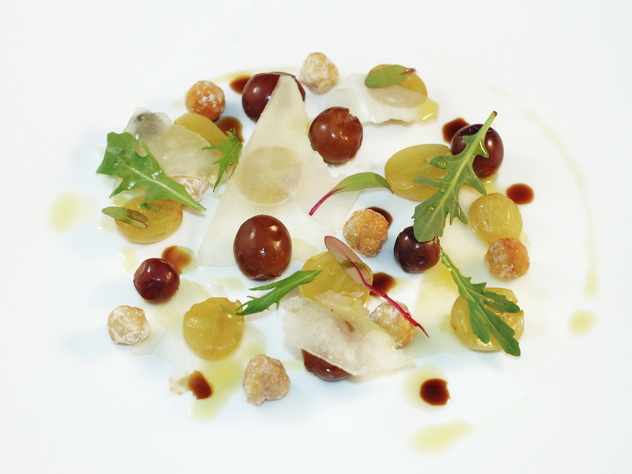 BOTTEGA'S INSALATA DE UVE  sous-vide grapes - dried grapes - pecorino - candied hazelnuts