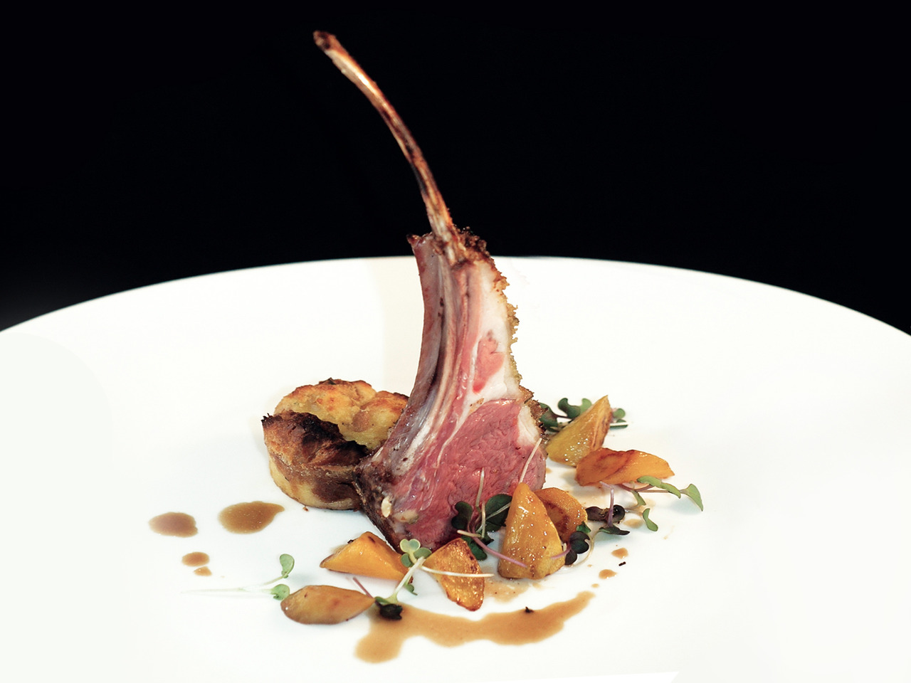 AD HOC'S HERB-CRUSTED LAMB  stewed carrots - spring onion bread pudding