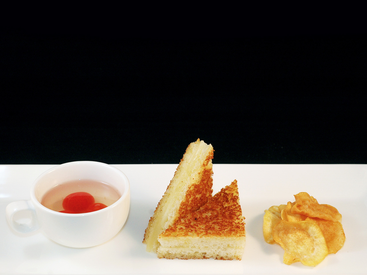 FRENCH LAUNDRY'S GRILLED CHEESE   grilled cheese - tomato consomme - sweet potato chips