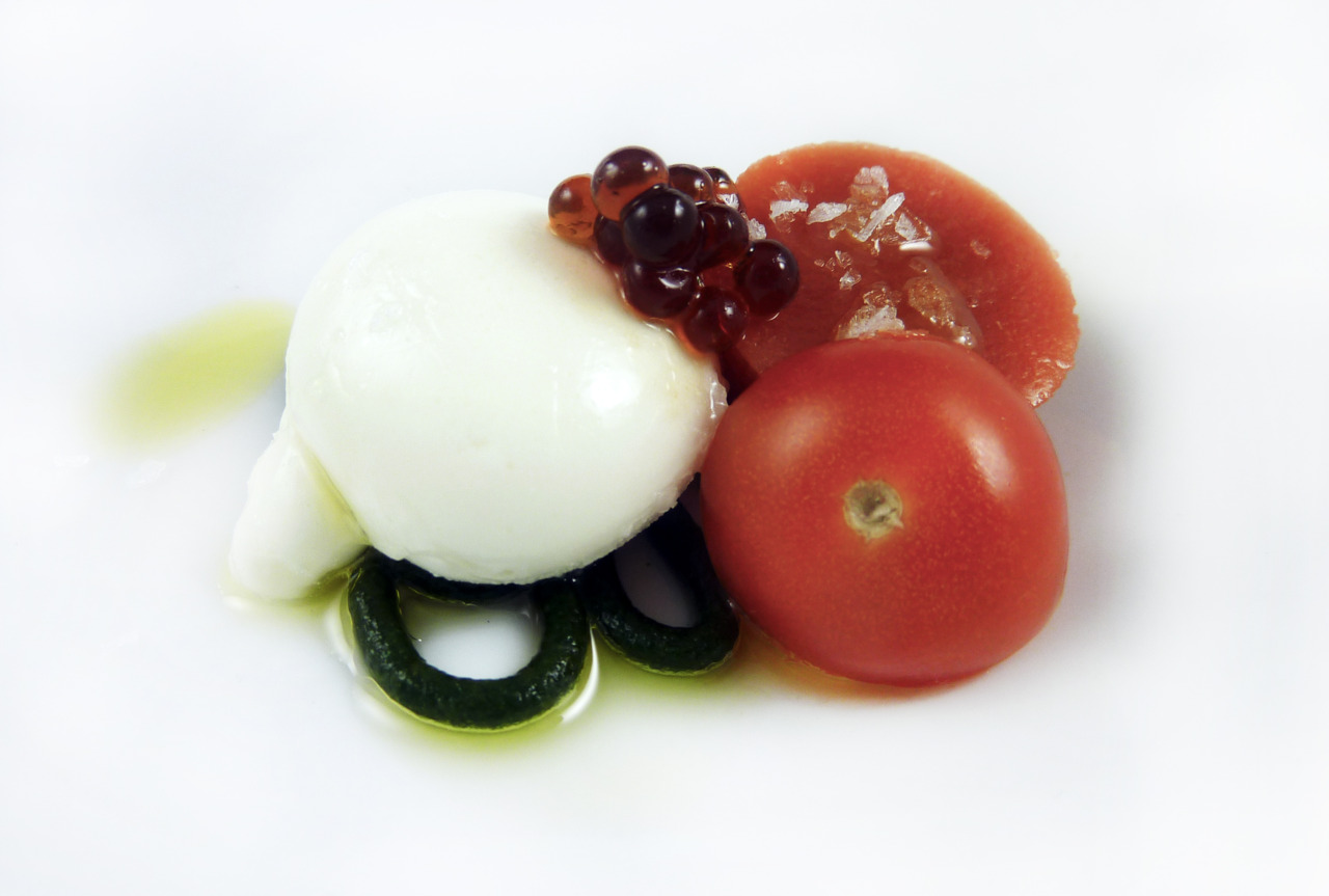 MOLECULAR CAPRESE    buffalo mozzarella sphere - tomato jello - basil spaghetti - balsamic caviar    This amuse was made up primarily of hydrocolloids. Although it's far removed from a traditional caprese, the taste is unmistakable once all the components hit the palate.