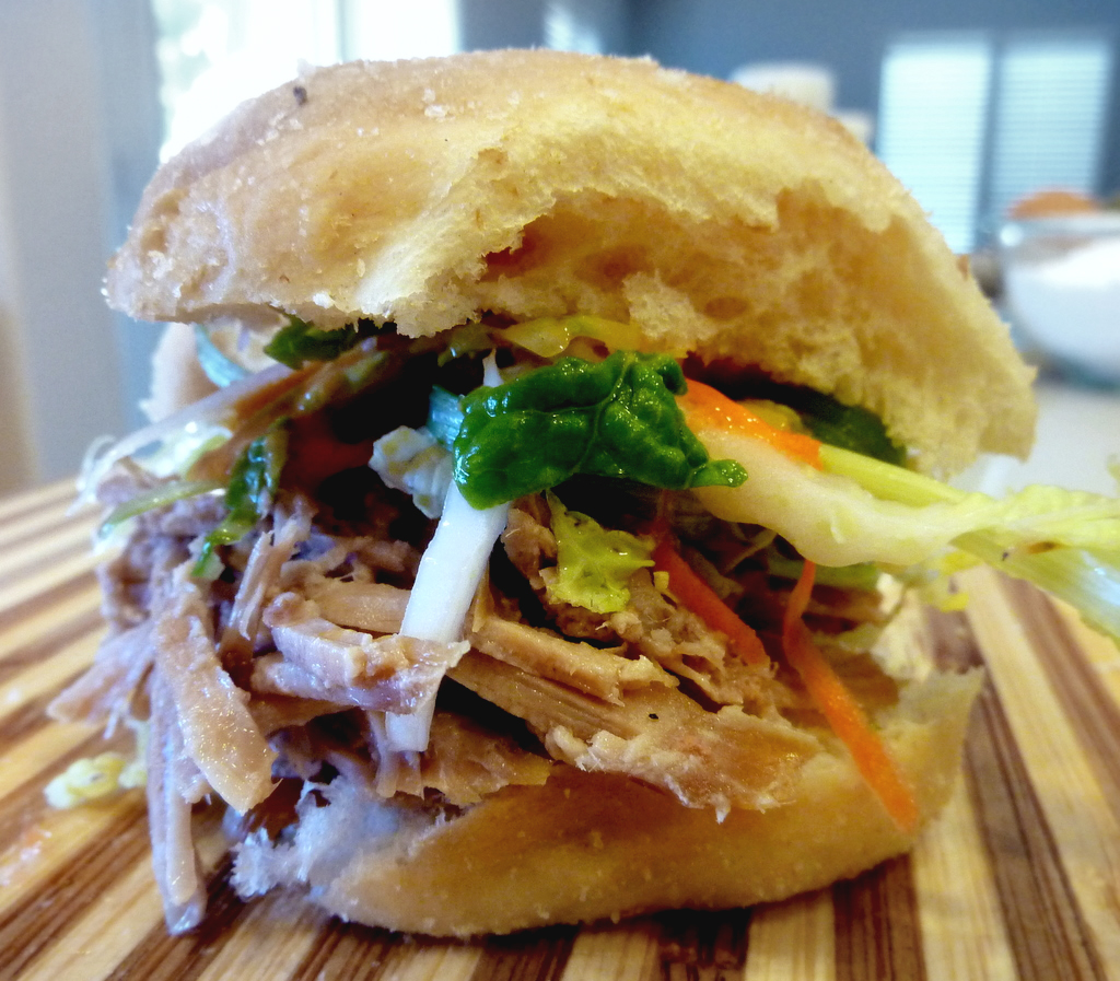 kalua pork slider   with habanero papaya slaw & hawaiian sweet bun    Made these for a party. Hawaiian-style pulled pork with a tropical coleslaw.
