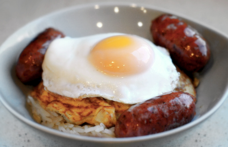 'longsilog'   longanisa sausage, torta, garlic rice, & fried egg    This Filipino breakfast is a nice change from its tired American cousin. Egg yolk is the simplest, most delicious sauce. This would be amazing in burrito form.