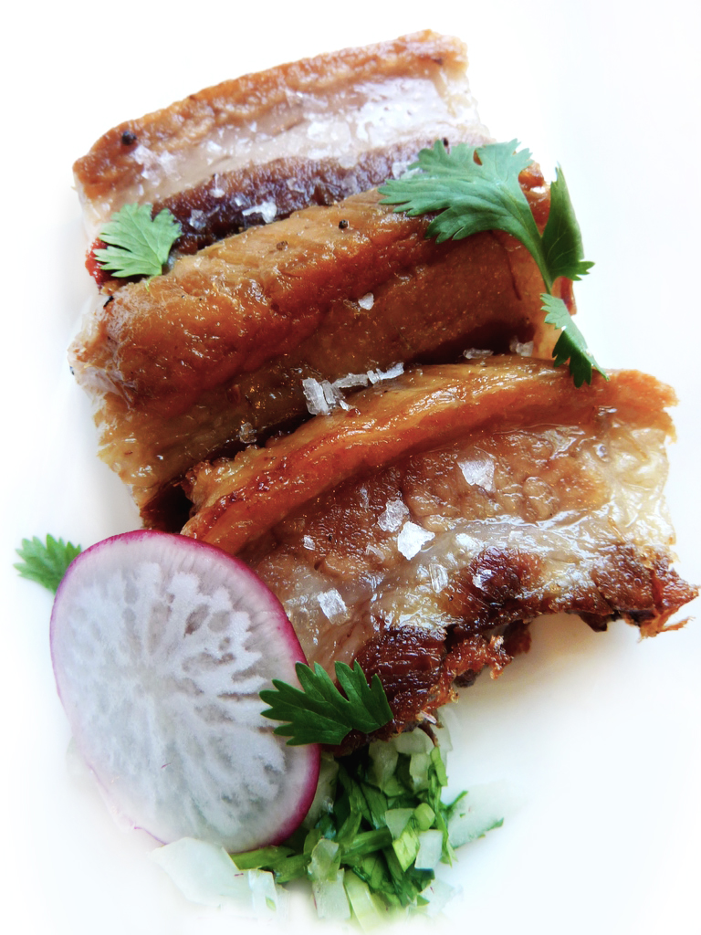 crispy braised pork belly   with maldon & cilantro    Slow-cooked, chilled, sliced, then rendered until golden. Crispy on the outside and delicately soft on the inside.