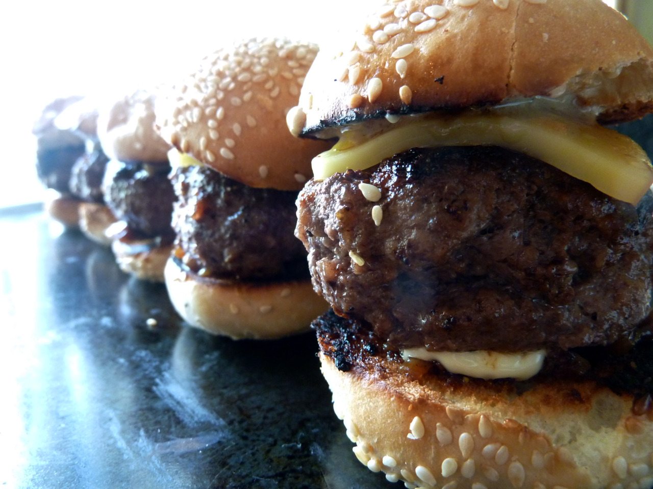 Mini-Burger Delux    Sliders I made for Mother's Day. Includes truffled foie gras, balsamic caramelized onions, chabot white cheddar. Yum .