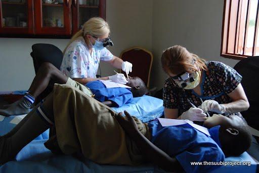 Kerri and Tonya working on the Children