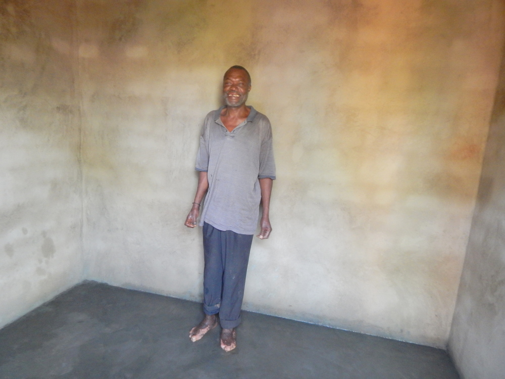 Yahaya standing inside his New house.JPG