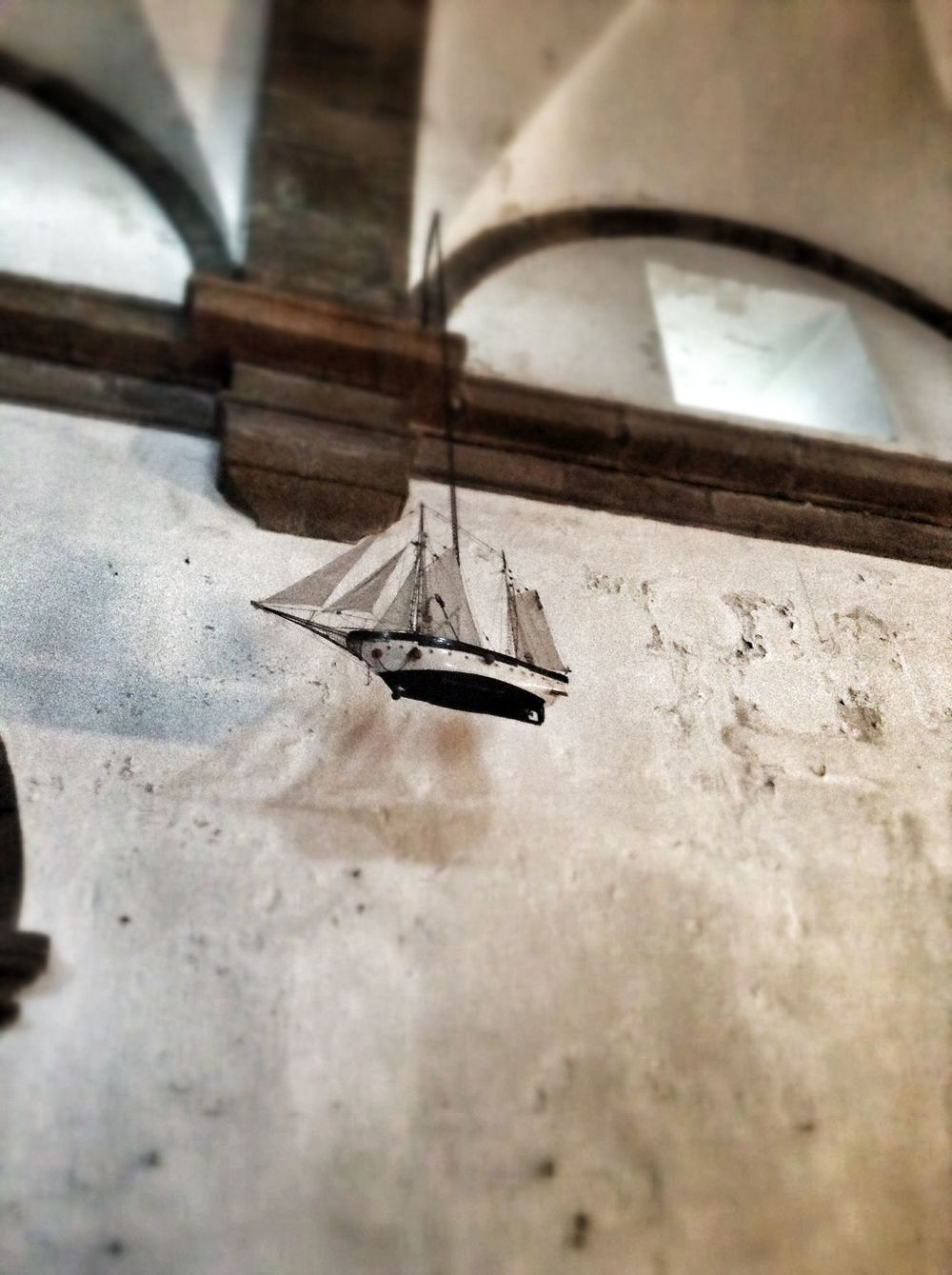 Model ship hanging within the church