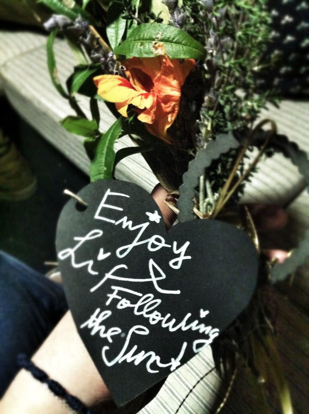 "Our leaving gift of herbs and flowers from the garden - it reads ""Enjoy life, following the sun"""