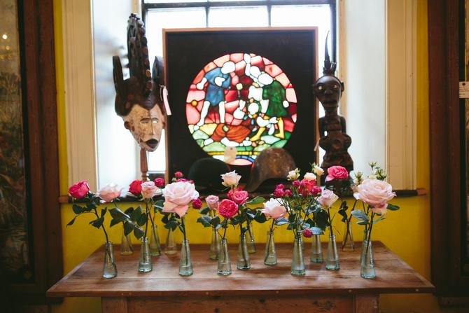 Rose display in campari bottles