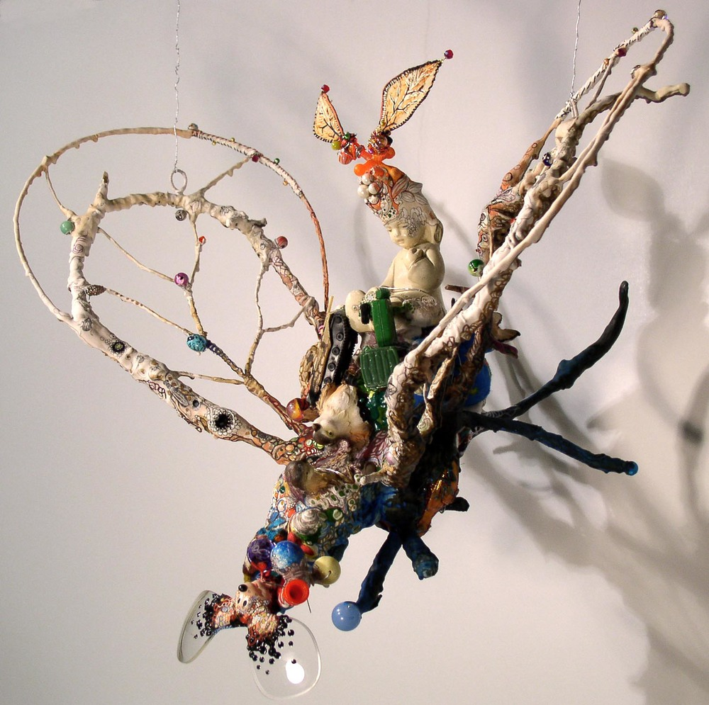 "Princess Mickey,   2009. Installed hanging from the ceiling at Heskin Contemporary, NYC.  Found objects, epoxy clay, wire, Aqua Resin, pen, gouache, pencil, fabric, thread. Variable dimensions, about 16"" x 18"" x 16"""