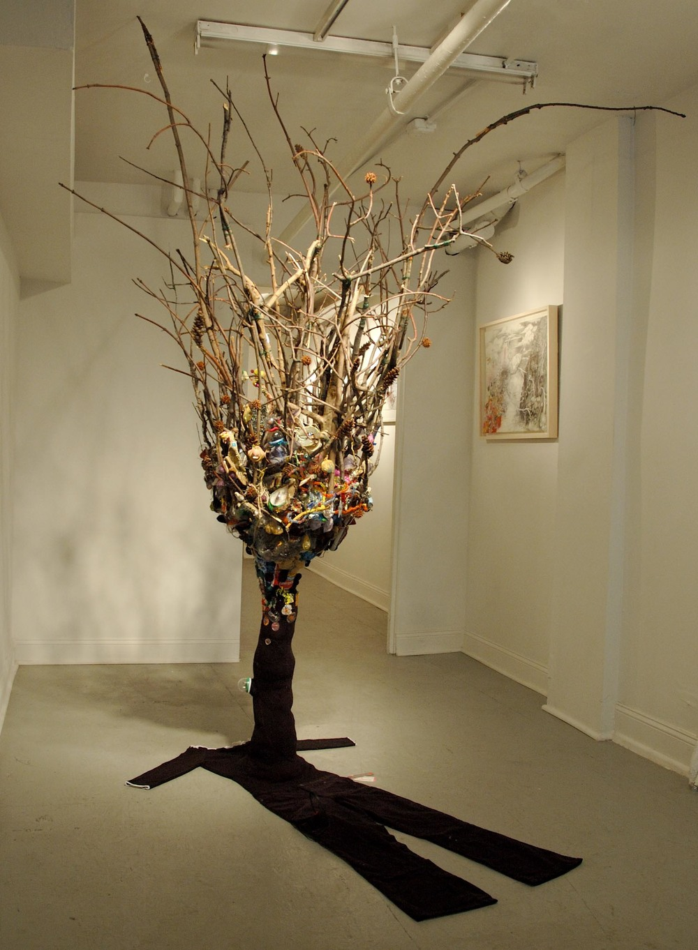 Trying Not To Die ,  2009.  Installed at Heskin Contemporary, NYC. Clothing, twigs, insects, trash, thread, fabric, wire. Variable Dimensions (clothing fits a 5' tall woman).