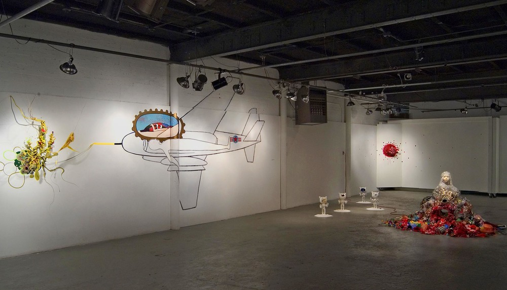 Too Much Candy,  2004. Installation at Living Arts, Tulsa, Oklahoma. Included in this view:  The Princess, Extreme Soldiers, Wound & Virus-Astrodeath.    *This exhibit was made possible with a grant from the Andy Warhol Foundation.