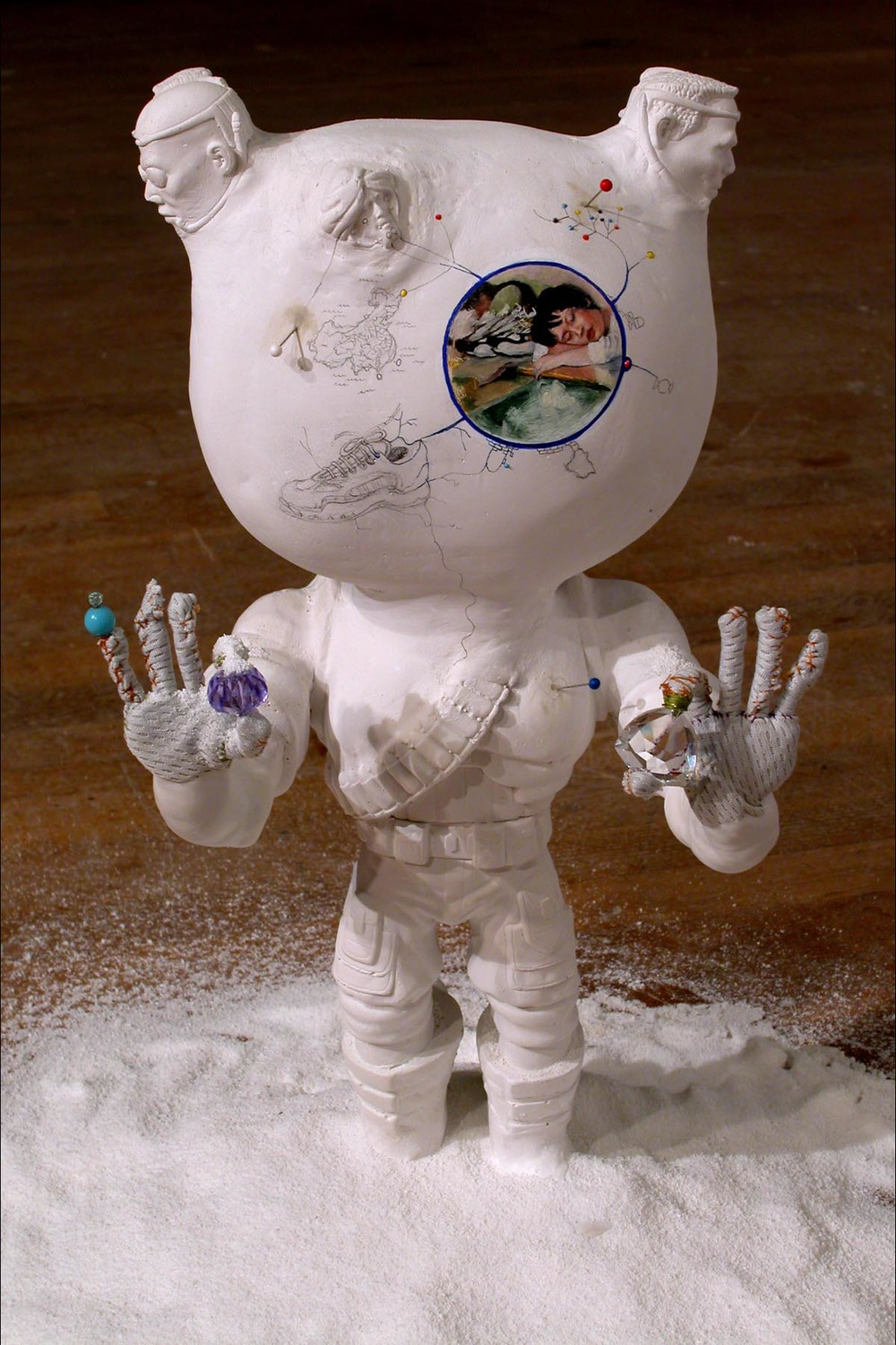 Extreme Soldier (Worker) , 2004. Installed at Living Arts, Tulsa, Oklahoma as part of  Too Much Candy .  Plaster, oil paint, fabric, thread, beads, detergent. Variable dimensions, about 22 inches tall.