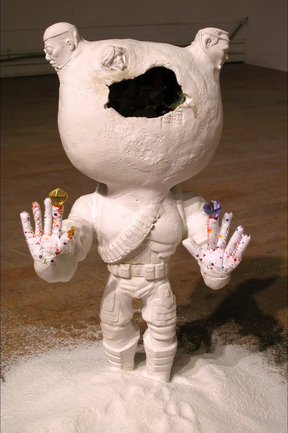 Extreme Soldier (Candy) , 2004.  Installed at Living Arts, Tulsa, Oklahoma as part of  Too Much Candy . Plaster, candy, resin, fabric, thread, beads, detergent. Variable dimensions, about 22 inches tall.