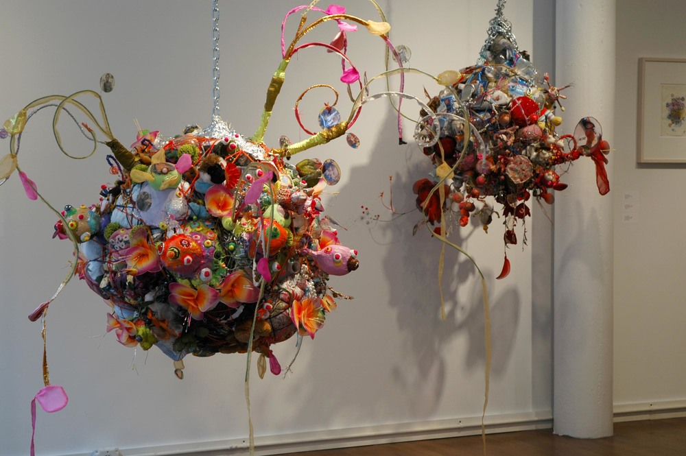 Bling Bling & Bling ,  Two sculptures installed at Ethan Cohen Gallery, NYC, 2006. Both are constructed of found objects bound together with extension cords, yarn and wire, adorned with stuffed and sewn fabric, styrofoam & Sculpty appendages and nodes. Variable dimensions:  Bling Bling  is about three feet in circumference not including wire fronds.  Bling  is about two feet in circumference.