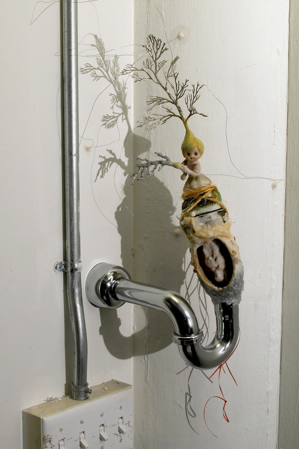 Pipe Girl,  2003. Pipe and other found objects, epoxy clay, gouache. Variable Dimensions.