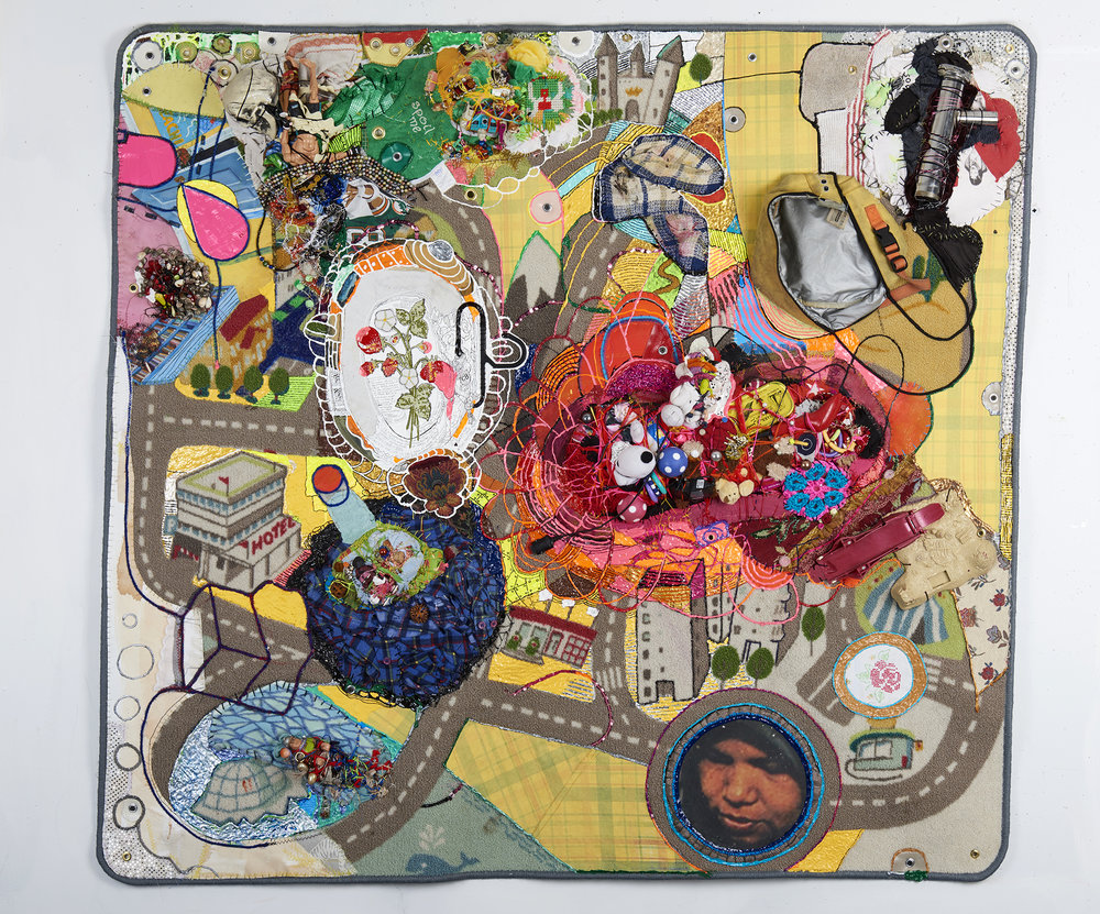 "Crawling on Cancer :       The Teflon Toxin by Sharon Lerner       2016, 52"" x 55"" x 6"",  trim, photo, resin, wood, thread, found objects, fabric paint, fabric, duct tape & grommets on my son's old Ikea carpet.  Note: ""The Teflon Toxin""  (known as C8) is found on most carpets and it is a carcinogen."