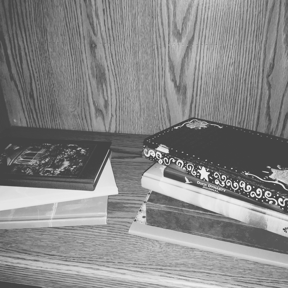 Her journals on the left, mine on the right. Pages filled with the openings of our hearts.