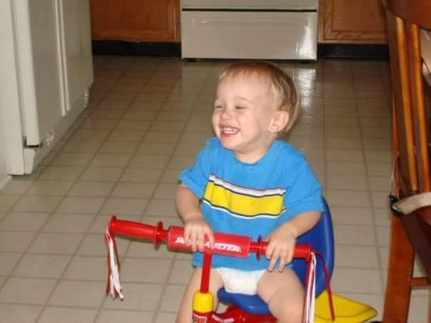 My oldest. The days when it was just he and I (a very pregnant me) and there was room enough to ride his trike indoors.