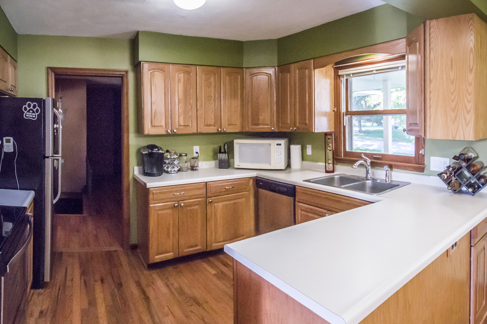 Changed:  Green paint (darker green above cabinets),  personal appliances.