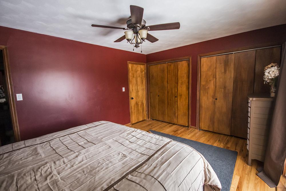 Changed: Dark red paint, bed, rug, door knob, closet door knob, fan, dresser, curtains.