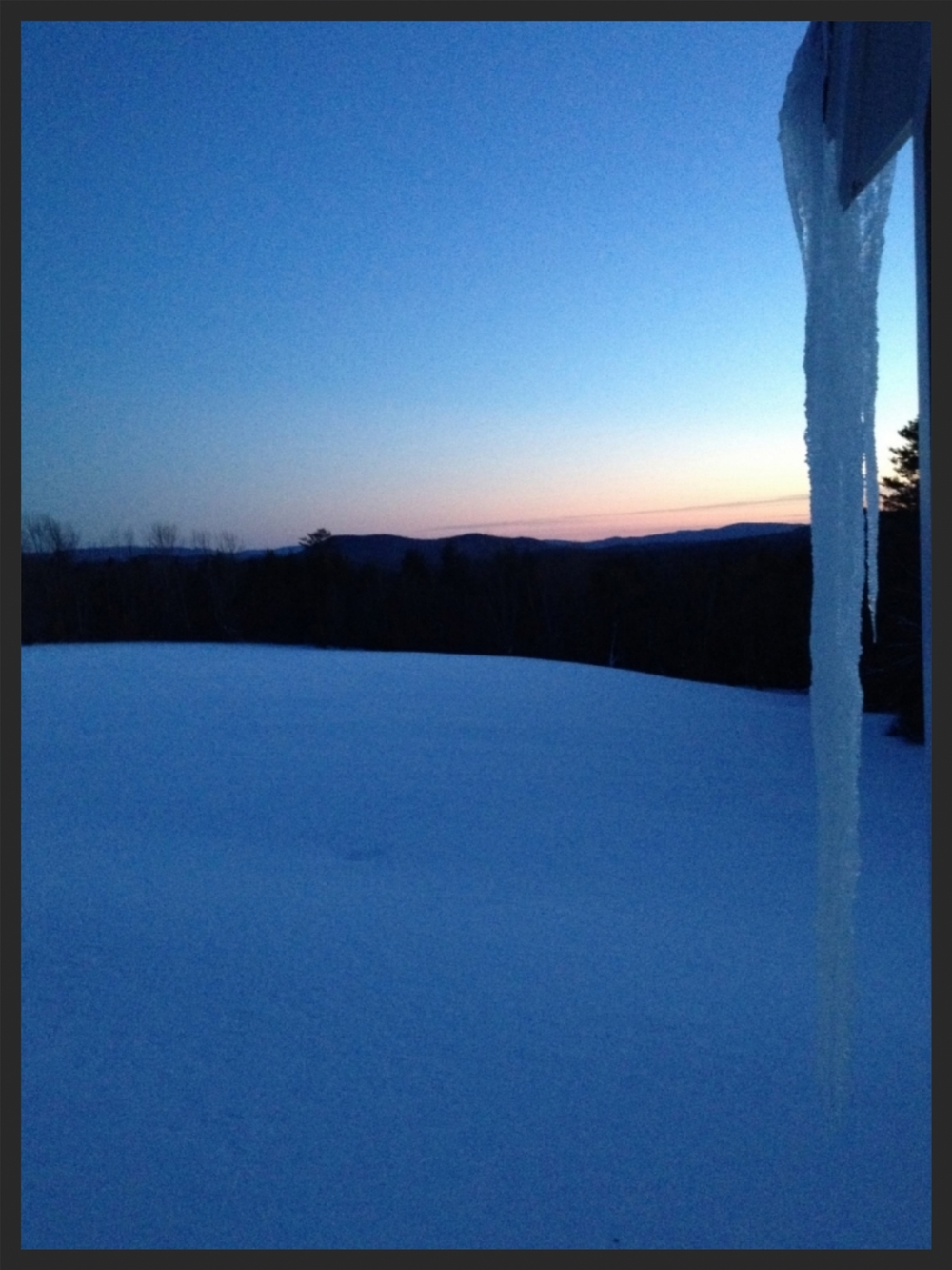 The beauty and perils of frozen water in front of a panoramic view looking toward Mt. Sunapee.