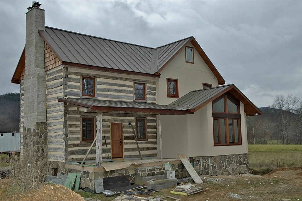 Log Cabin with Wood Grain Laminated UPVC Windows
