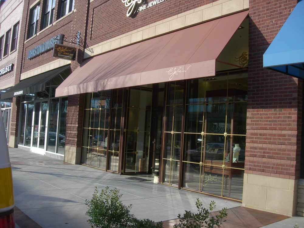 Commercial Storefront with Entry Door in UPVC with Wood Grain Finish