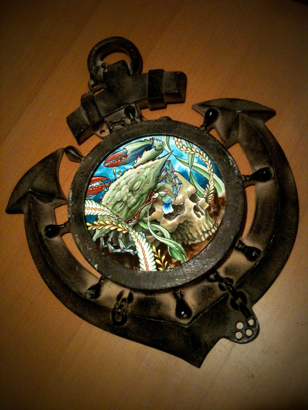 Crab and skull in anchor frame.