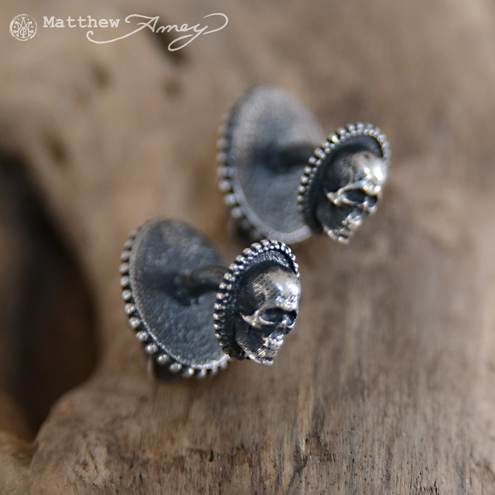 A view of the back of the cufflinks. Tiny skulls fit through any button hole and will keep the cuff closed and stylish.