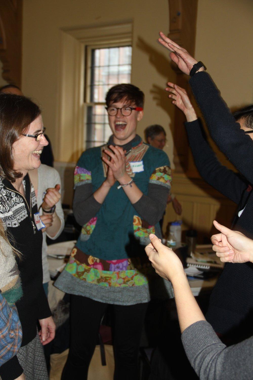Participants enjoy a Rock, Paper, Scissors tournament to energize themselves mid-training.