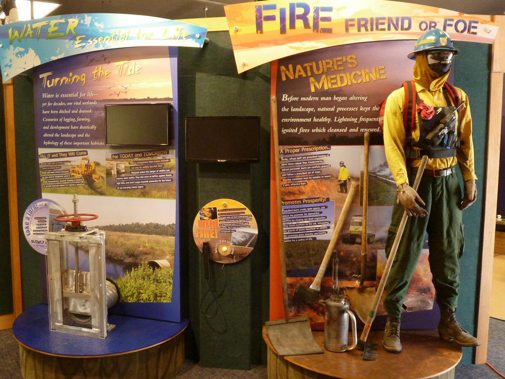 An interactive display features a working model of a water control structure for visitors to see firsthand how it operates.