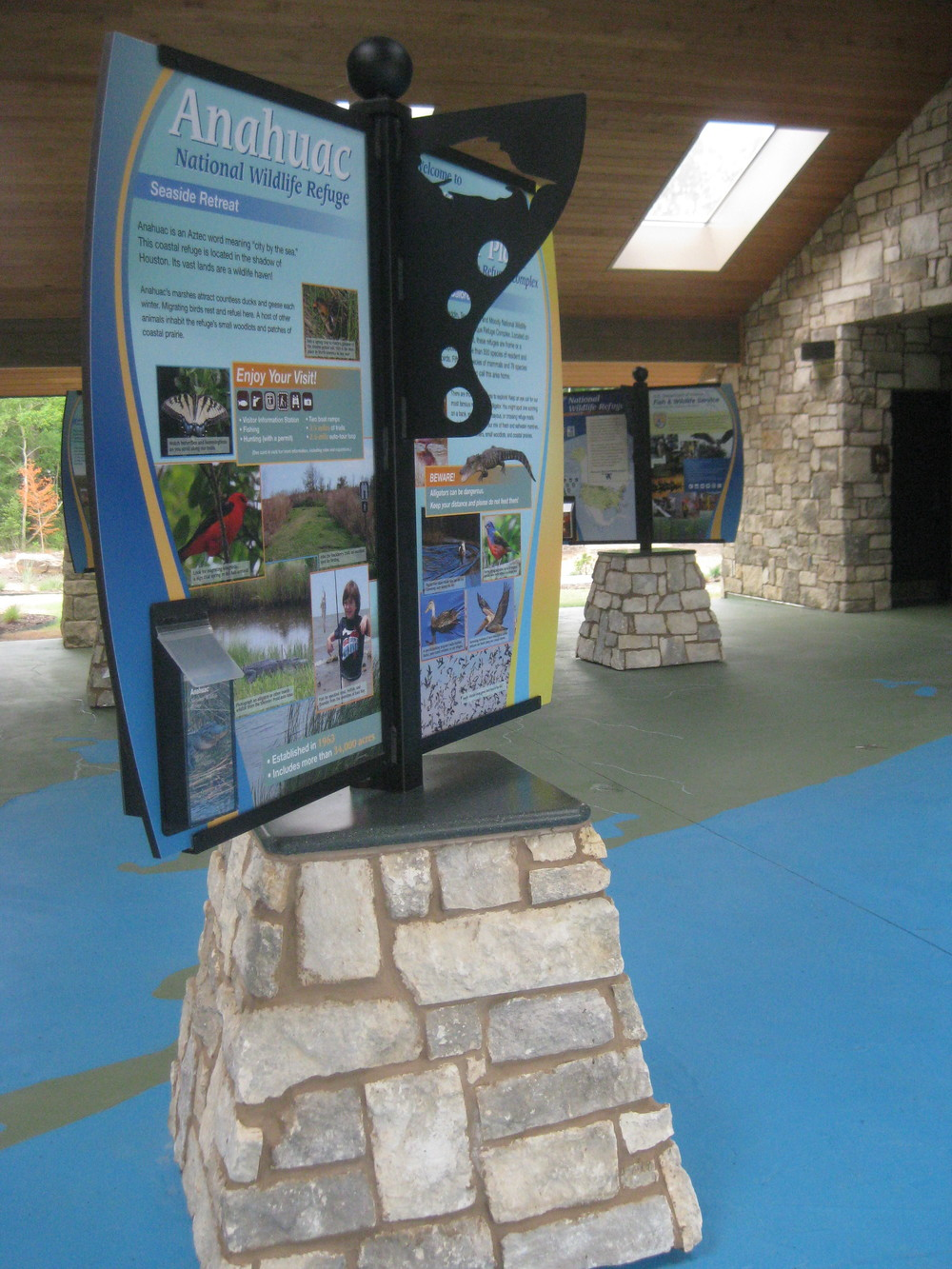 Outdoor kiosks feature custom stone work to match the existing breezeway walls. Decorative powder-coated metal mounts hold fiberglass embedment panels that are easily cleaned or replaced if vandalized.