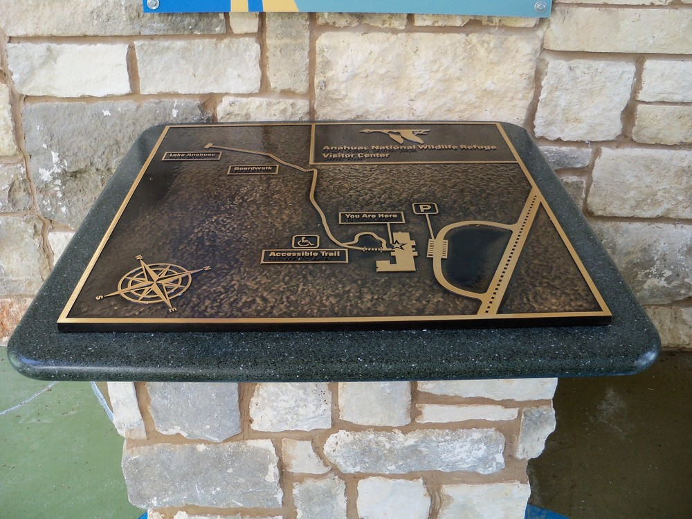 An outdoor, bronze, tactile relief map provides accessibility.