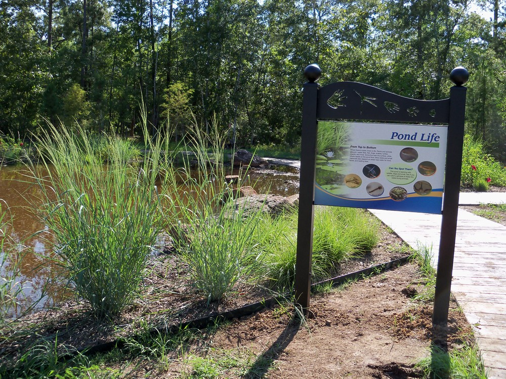 Decorative, custom-designed, metal panel mounts draw visitors outside and onto the walking trail. Vandal-resistant security-head fasteners are used in all indoor and outdoor displays.