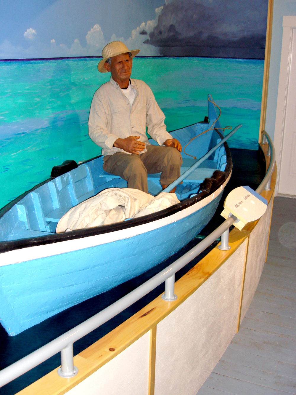 A large hand-painted mural sets the stage for the Life on the Sea exhibit. A historic fishing boat is securely displayed and features an animatronic fisherman who's audio tells historic tales of the sea.