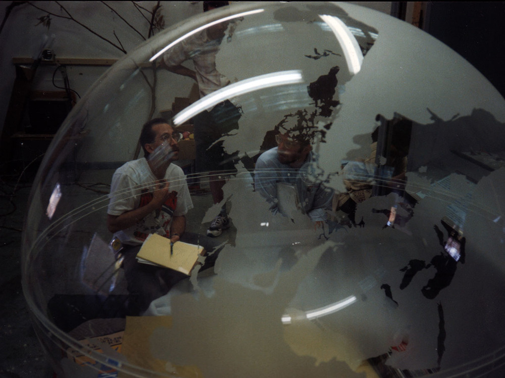 Dave Sims, right, fabricating the globe.